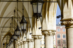 Historic and efficient gas lighting of Cloth Hall. KRAKOW, POLAND - FEBRUARY 26, 2014: Photo of well preserved historic and efficient gas lighting under the Royalty Free Stock Photography