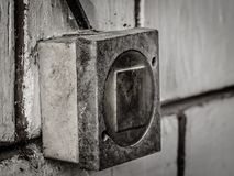 Historic electric switch fastened to the wall stock images