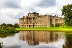 Historic English Stately Home. Lakeside view of the Lyme Hall in Chesire, England Stock Images
