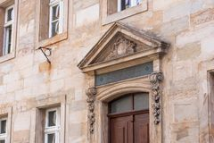 Historic entrance portal made of sandstone in the old town of Bayreuth stock photography