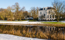 Historic estate at the water in wintertime Stock Photo