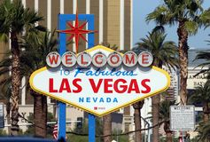 Historic Fabulous Las Vegas Sign. Photo of the Historic Welcome to Las Vegas Sign with palm trees and Mandalay Bay in background Stock Photo