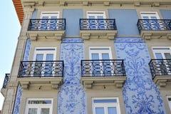 Traditional historic facade in Porto blue tiles. Historic facade in Porto decorated with blue hand painted tin-glazed tiles azulejo Porto, Portugal Royalty Free Stock Photos