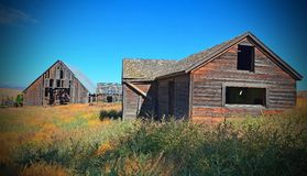 Historic Farm House and Barn. This is a old abandoned Farm House and Barn in Oregon Royalty Free Stock Photos
