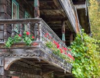 Historic farmhouse front with red geraniums. Stock Photography