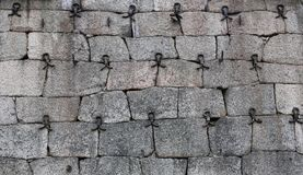Historic fieldstone wall reinforced with wrought iron parts.  Royalty Free Stock Images