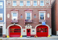 Historic Firehouse Red Doors. Red doors of historic Charlestown Fire Department Engine 50 firehouse, near Bunker Hill, Boston, Massachusetts, MA Stock Photo