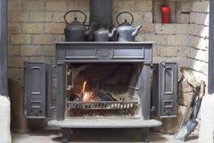 Historic fireplace, teakettles,  Ireland Stock Photography