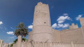 Historic fort at the Museum of Ajman timelapse hyperlapse, United Arab Emirates. Historic fort at the Museum of Ajman timelapse hyperlapse with blue cloudy sky royalty free stock image