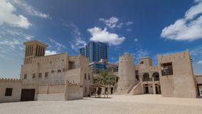 Historic fort at the Museum of Ajman timelapse hyperlapse, United Arab Emirates. Historic fort at the Museum of Ajman timelapse hyperlapse with blue cloudy sky Royalty Free Stock Photo