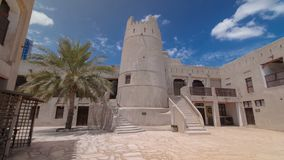 Historic fort at the Museum of Ajman timelapse hyperlapse, United Arab Emirates. Historic fort at the Museum of Ajman timelapse hyperlapse with blue cloudy sky stock photography