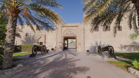 Historic fort at the Museum of Ajman timelapse hyperlapse, United Arab Emirates. Historic fort at the Museum of Ajman timelapse hyperlapse with blue cloudy sky stock photos
