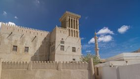 Historic fort at the Museum of Ajman timelapse hyperlapse, United Arab Emirates. Historic fort at the Museum of Ajman timelapse hyperlapse with blue cloudy sky royalty free stock photos