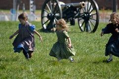 Historic Fort Wayne Detroit MI. Children playing at a Civil War reenactment camp Royalty Free Stock Image