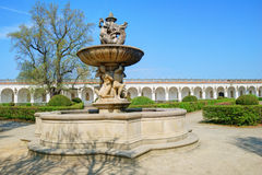 Historic fountain and long white colonnade Royalty Free Stock Photo