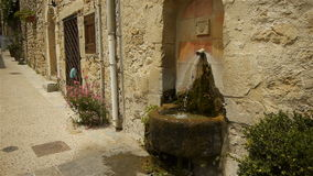 Historic fountain at St Guilhem le Desert, Cevennes France stock video footage