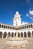 Historic Fountain. View of the campanile of San francisco Xavier University in Sucre, Bolivia, with its patio's archway and fountain Stock Image
