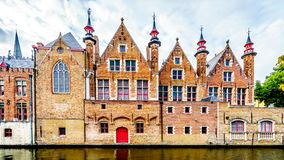 The historic gables of the rear of Brugse Vrije building on the Groenerei Canal in Bruges, Belgium stock photography