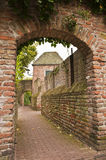 Historic gate and alley Royalty Free Stock Images