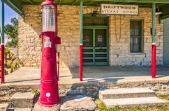 Historic general store building with antiqu gas pump in Driftwood, Texas. Front entrance to historic general store in Driftwood, Texas with red, antique gas pump Stock Images