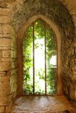 Historic window with stone arch Royalty Free Stock Photography