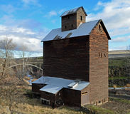 Historic Grain Storage building & Small Bridge. This storage building is in great shape for as old as it is this is bye a small town called Womic, Oregon Stock Photography
