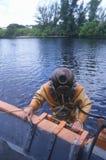 Historic Greek sponge diver in antique diving suit Royalty Free Stock Photos