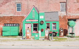 Historic green Conoco garage, Commerce. Historic quaint green Conoco garage with rusting pumps no longer in use in town of Commerce, Oklahoma, USA on Route 66 on Royalty Free Stock Image