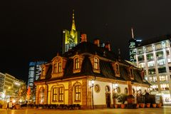 Historic Hauptwache in front of the Commerzbank Tower in Frankfurt, Germany, at night royalty free stock image