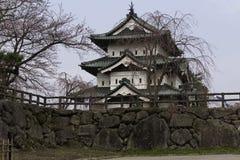 The Historic Hirosaki Castle. Hirosaki Park, Aomori Japan April 15, 2016 Hirosaki Castle as seen through the cherry trees in Aomori, Japan. Editorial Use Only Royalty Free Stock Photography