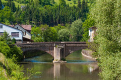 The historic Hirschbrücke with river Nagold in Wildberg Stock Images