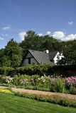 Historic Home And Flower Garden Stock Image