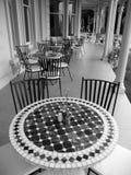 Historic home: verandah cafe tables Stock Photography