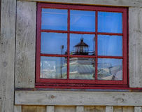 Historic Hooper Strait Lighthouse reflected in Window. Historic and restored Hooper Strait Lighthouse reflected in paned wood shop window Royalty Free Stock Image