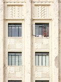 Historic hotel architecture. Historic building details, windows and peeling paint Stock Image