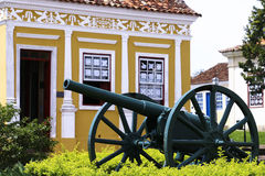 Historic house and cannon in Lapa (Brazil). Royalty Free Stock Photo