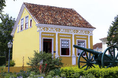 Historic house and cannon in Lapa (Brazil). Stock Photo