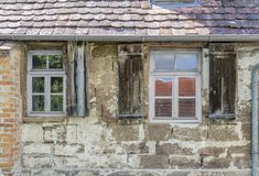Historic house facade. With rundown windows stock photography