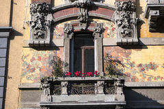 Historic house in Milan. Window and balcony with plants and flowers in Milan (Lombardy, Italy) in Liberty style Royalty Free Stock Photography
