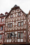 Historic house with nostalgic clock, trier Stock Photography