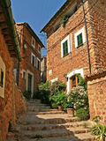 Historic houses and alleyway in fornalutx, majorca. Historic house facades and stairway in the ancient village fornalutx, majorca stock image