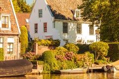 Historic houses alongside the Dutch river Vecht Royalty Free Stock Photos