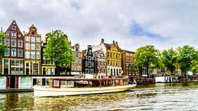 Historic houses dating back to the Middle Ages in the old city of Amsterdam Stock Photos