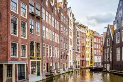 Historic houses on the Ouderzijds Achterburgwal canal in the red light district of the old city center of Amsterdam stock photo