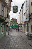 Historic houses with people downtown medieval Canterbury city, E. CANTERBURY, ENGLAND - JUNE 07, 2017: Old historic houses with people downtown medieval Stock Image