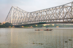 Historic Howrah bridge on the river Ganges. Howrah Bridge is a cantilever bridge with a suspended span over the Hooghly River. Stock Image