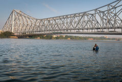 Historic Howrah bridge on the river Hooghly Ganges. Royalty Free Stock Photo