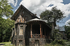 Historic hunting lodge with a facade lined with bark of cork oak. In Poland Stock Photography