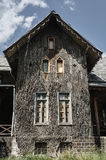 Historic hunting lodge with a facade lined with bark of cork oak. In Poland Royalty Free Stock Images