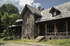 Historic hunting lodge with a facade lined with bark of cork oak. In Poland Stock Images